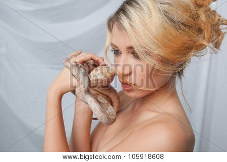 Beautiful girl and the snake Boa constrictors, which wraps around her face