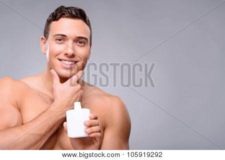 Handsome guy taking care of himself