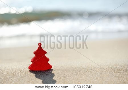 Red Christmas Tree On Sand Beach
