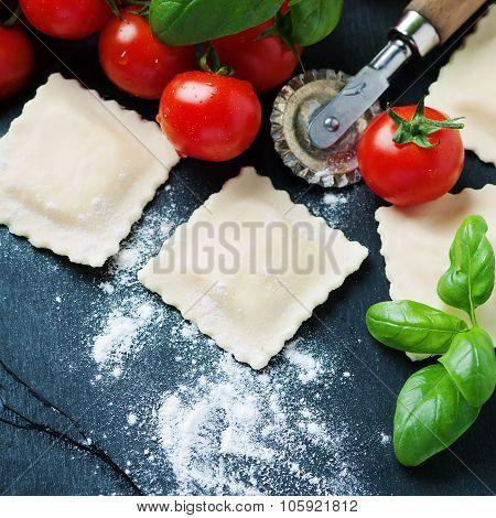 Uncooked Ravioli With Tomato And Basil