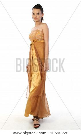 Teenage girl with beautiful strapless gold gown