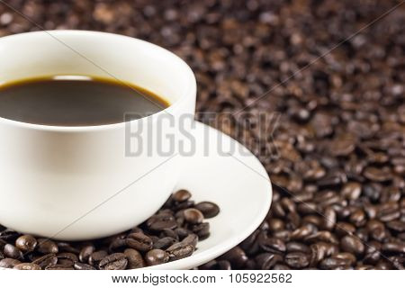 A Cup Of Coffee And Coffee Beans Background, Warm Toning, Selective Focus