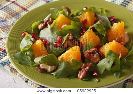 Salad With Pomegranate, Oranges, Walnuts And Arugula Close-up