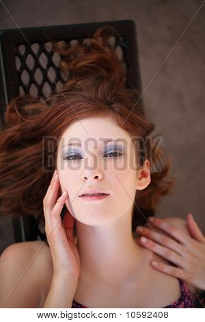 Young Teen Girl Portrait Reclining From Above