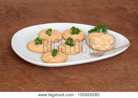 plate of salmon pate crackers