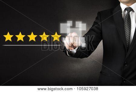 Businessman touching five stars