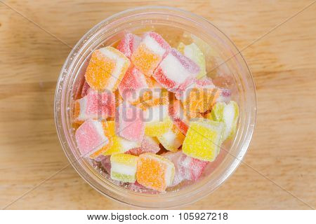 Colorful Gummy candy rainbow on wooden background