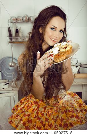 crazy housewife on kitchen smiling eating cakes