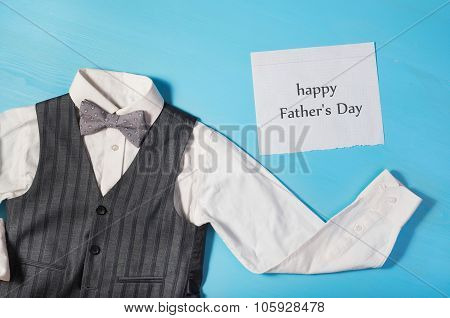 White Shirt, Gray Vest And Bow Tie