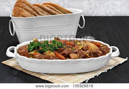 Healthy Beef Stew In An Oval White Casserole.