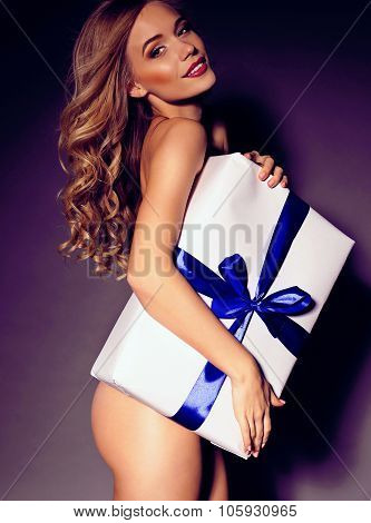 Festive Photo Of Sexy Blond Woman Holding A Great Gift Closing Naked Body