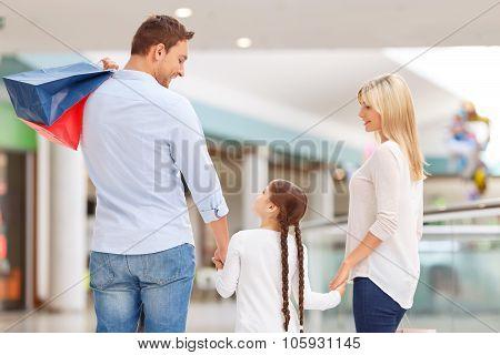 Friendly family walking around shopping mall