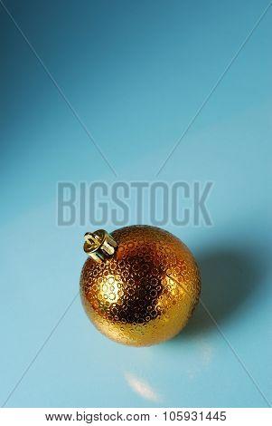 Golden christmass ball on a blue background
