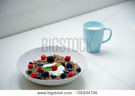 Breakfast With Glass Of Mik And Integral Musli With Berries Mix On Blank Table
