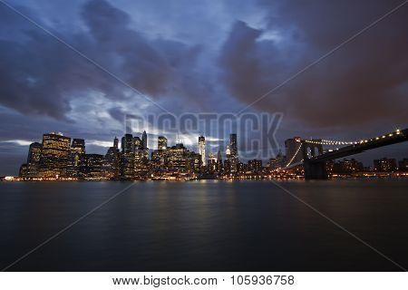 New York, United States - June 12, 2013: New York - Brooklyn Bridge and Lower Manhattan at dusk