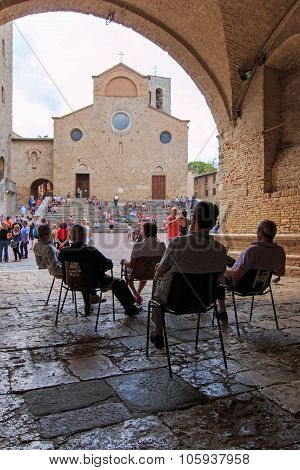 San Gimignano, Italy - August 14 2014: Old people in San Gimignano - Tuscany