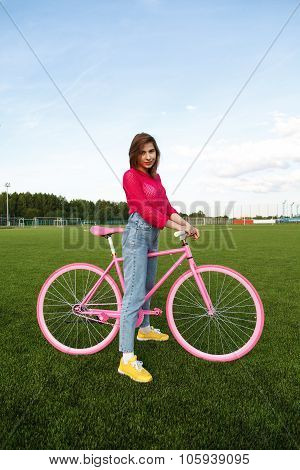 Portrait Of Girl With A Bike Outdoors