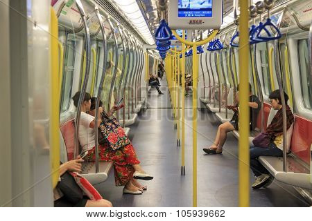 Kowloong, Hong Kong - August 13,2015: Commuters Inside A Train Of The Mtr Of Hong Kong, The Most Pop