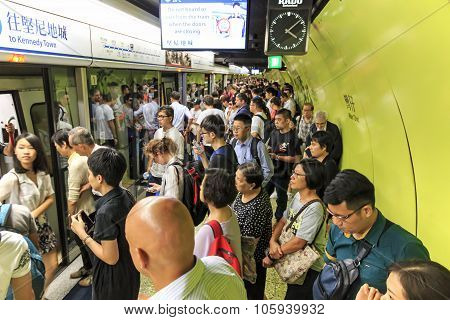 Kowloon, Hong Kong - August 14,2015: Commuters Waiting For A Train In The Mtr Wan Chai In Hong Kong