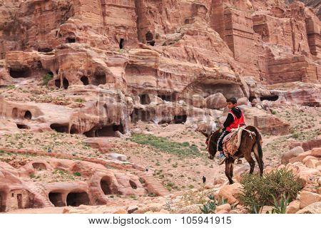 Petra, Jordan - March 26, 2015: Local Jordanin Guide Exploring The Ruins Of Ancient Petra, Jordan