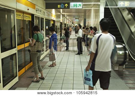 Commuters Waiting At Taipei Mrt