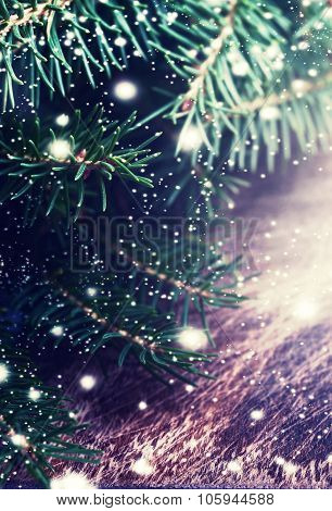 Christmas Fir Tree On Dark Wooden Board - Winter Background With Falling Snow. Card Or Invitation.