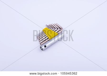 Allen Keys In Yellow Clamp On White Background