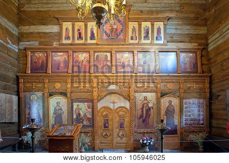 Iconostasis In Ancient Wooden Christian Church. Russia