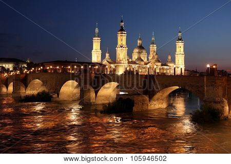 View Of The Basilica Of The Virgen Del Pilar And Ebro River, On The Right Is The Medieval Bridge