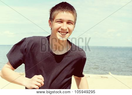 Happy Young Man At Seaside