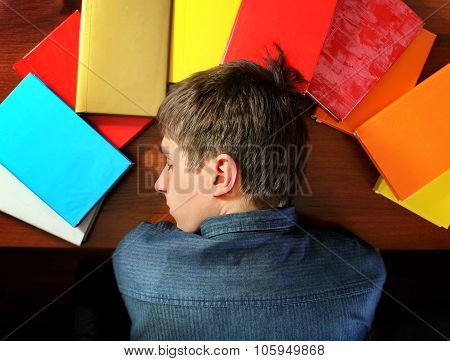 Young Man Sleep On The Books