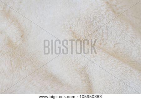 Blurring Background Of Soft Tissue. Beige Background Of Plush Fabric