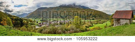 beautiful autumn mountain and small village on mountainside