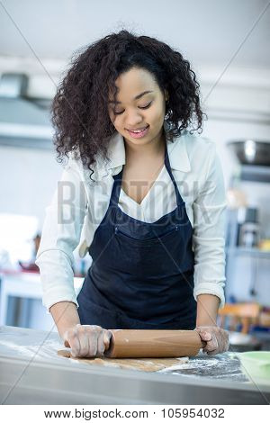 young girl learns to cook cakes in the bakery
