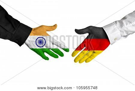 India and Germany leaders shaking hands on a deal agreement