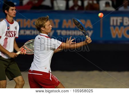 MOSCOW, RUSSIA - JULY 19, 2015: Daria Churakova (center) and Nikita Burmakin of Russia in the final match of Beach Tennis World Team Championship against Italy. Italy become world champion