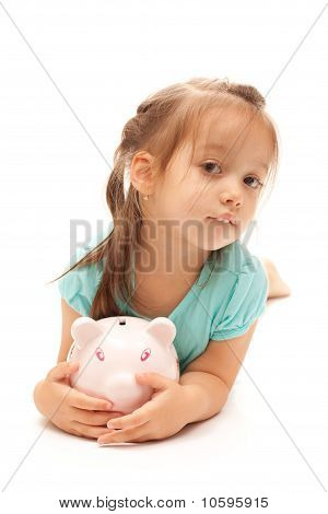 Young Little Girl Holding A Piggy Bank