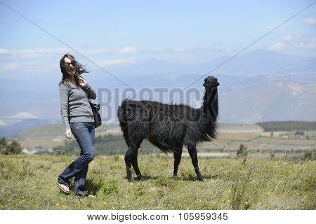 Llama and a woman