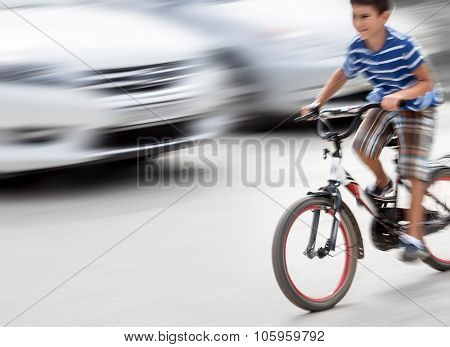 Dangerous City Traffic Situation With A Boy On Bicycle