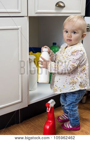 Toddler Playing With Cleaning Products