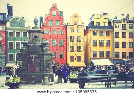 STOCKHOLM, SWEDEN - May 20, 2015: Tourists near the two most famous houses on Stortorget square in Stockholm. Retro style filtered image