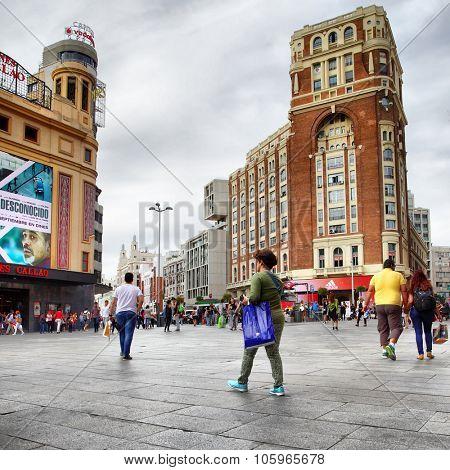 MADRID, SPAIN - September 23, 2015: People on Plaza Callao and Gran Via street (Spanish Broadway) in Madrid