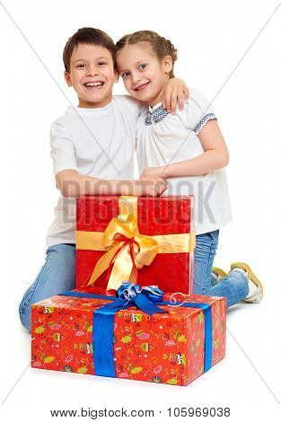 boy and girl with red gift box and golden bow - holiday object concept isolated