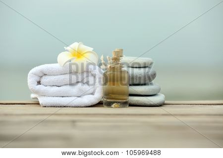Beautiful spa composition with towels outdoors