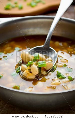Vegetarian soup with beans and vegetables