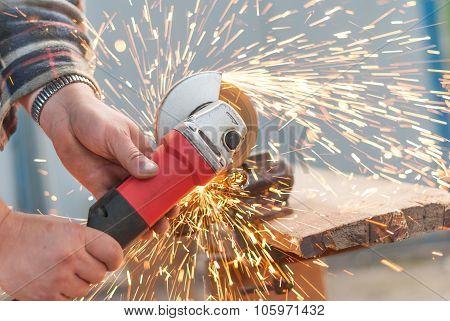 Man Cuts Off A Piece Of Metal.