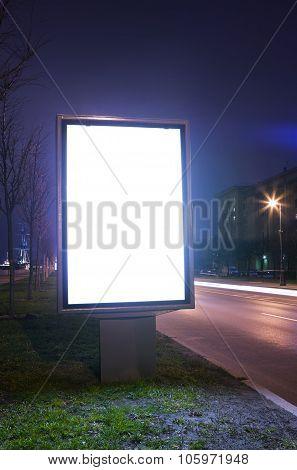the illuminated billboard at a dark night