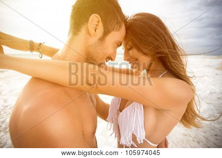 Smiling couple in love embracing and looking each other