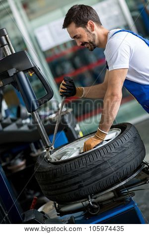 Engineer diagnostics tyre in workshop