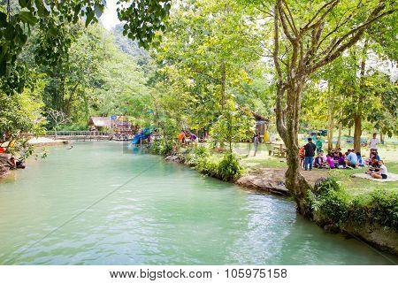 Tourists enjoy at Blue Lagoon, Vangvieng, Laos